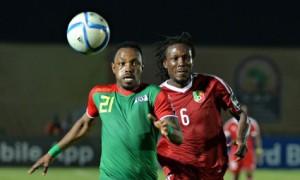 Congo defender Dimitry Davy Magnokele Bissiki, right, challenges Burkina Faso's Abdou Razack Traoré